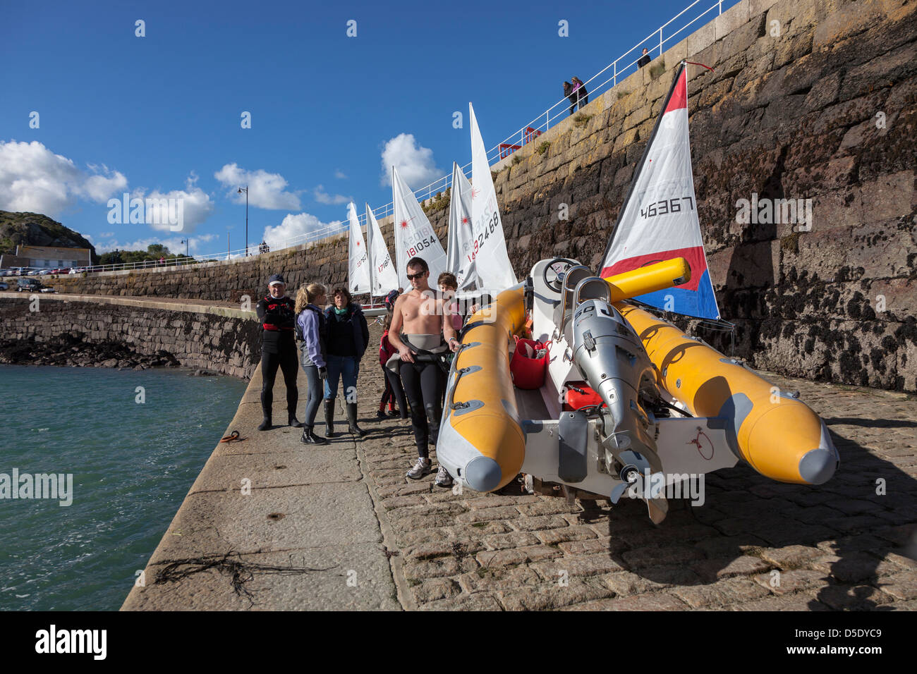 Launching inflatable outboard boat, St Catherine's breakwater, Jersey, Channel Islands, UK - Stock Image