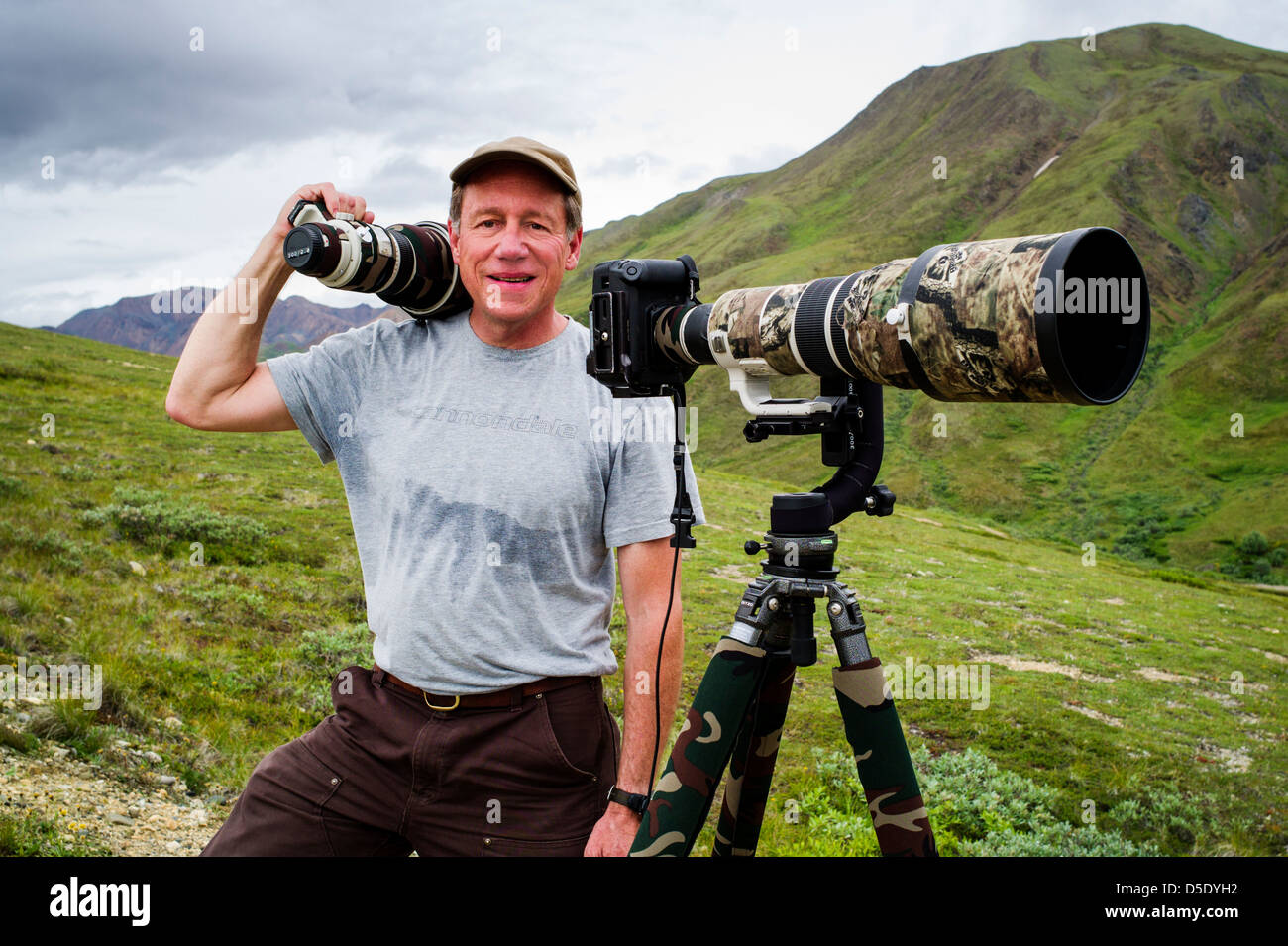 Portrait of professional photographer with large telephoto lens & tripod, Denali National Park, Alaska, AK - Stock Image