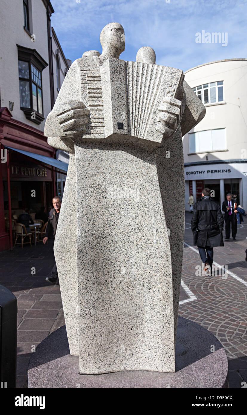 People Walking Past Les Jongleurs Modern Art Statue By