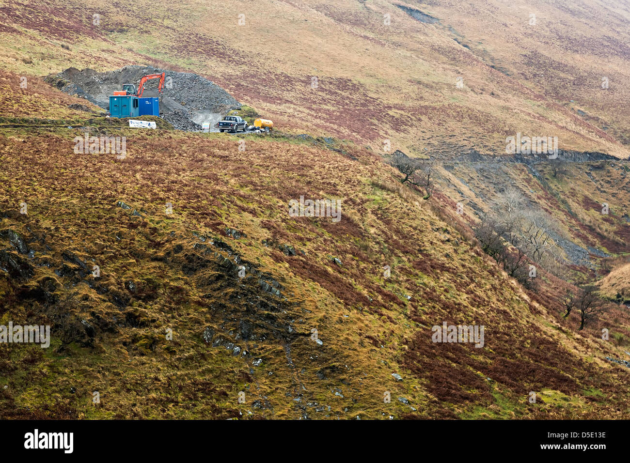 Laying pipeline through open moorland near Cwmystwyth, Wales, UK - Stock Image