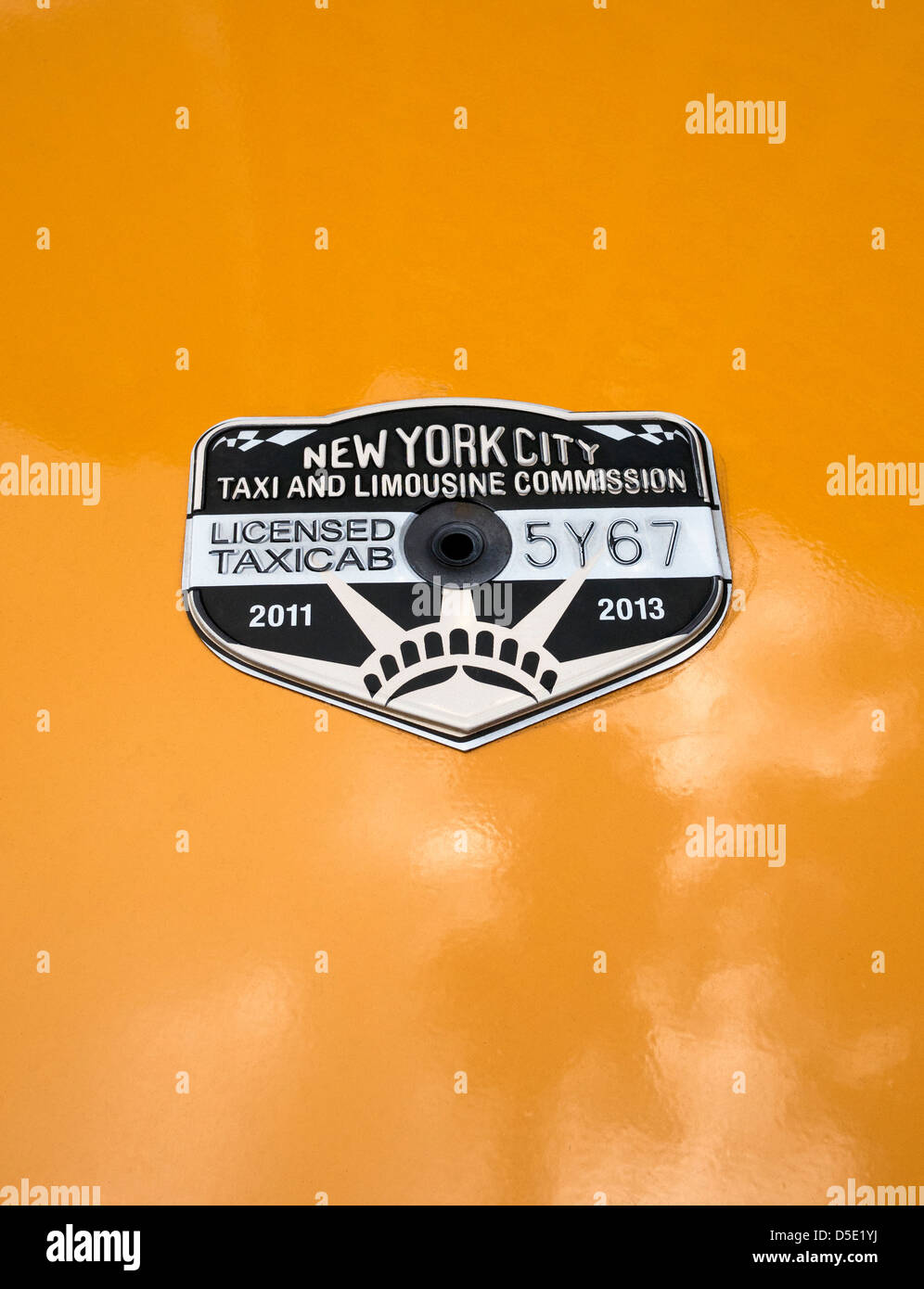 New York taxi medallion license for a yellow taxi - Stock Image