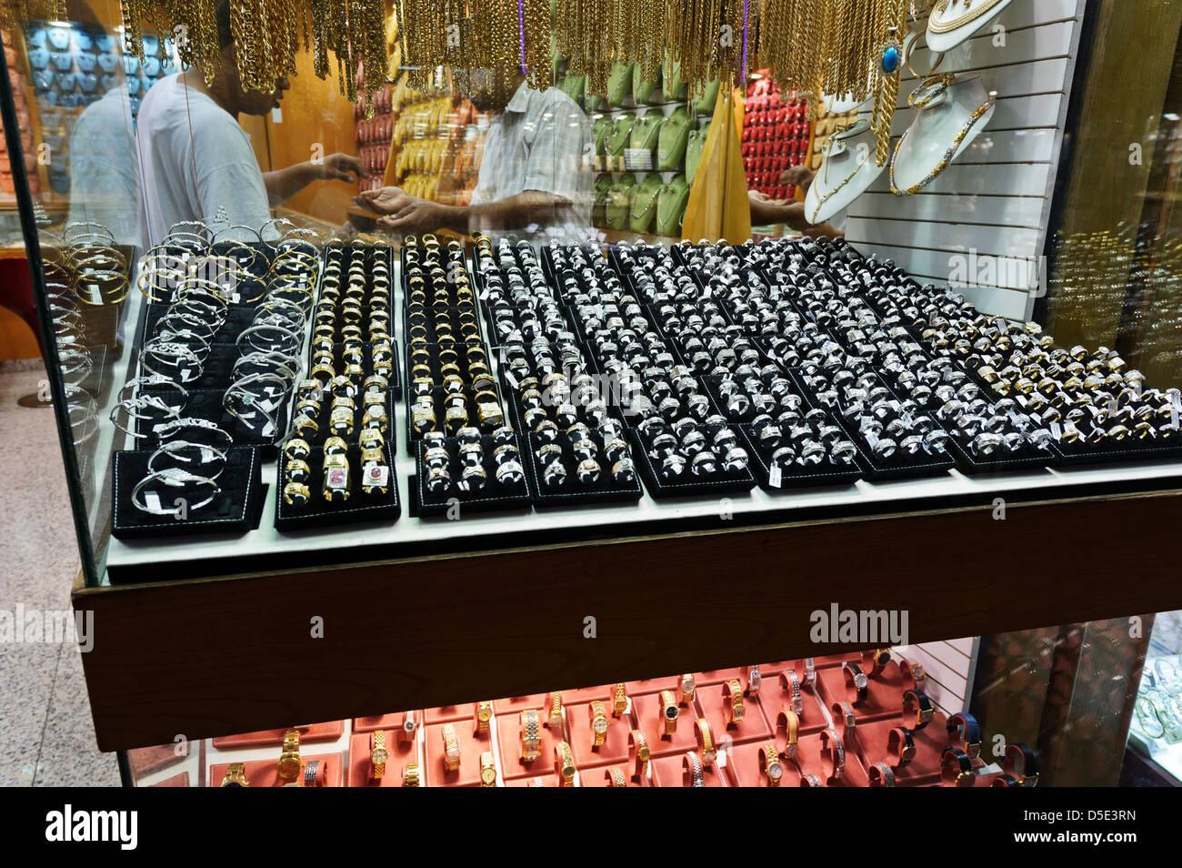 Gold and silver rings on display for sale, Dubai Gold souk, Dubai, United Arab Emirates. - Stock Image