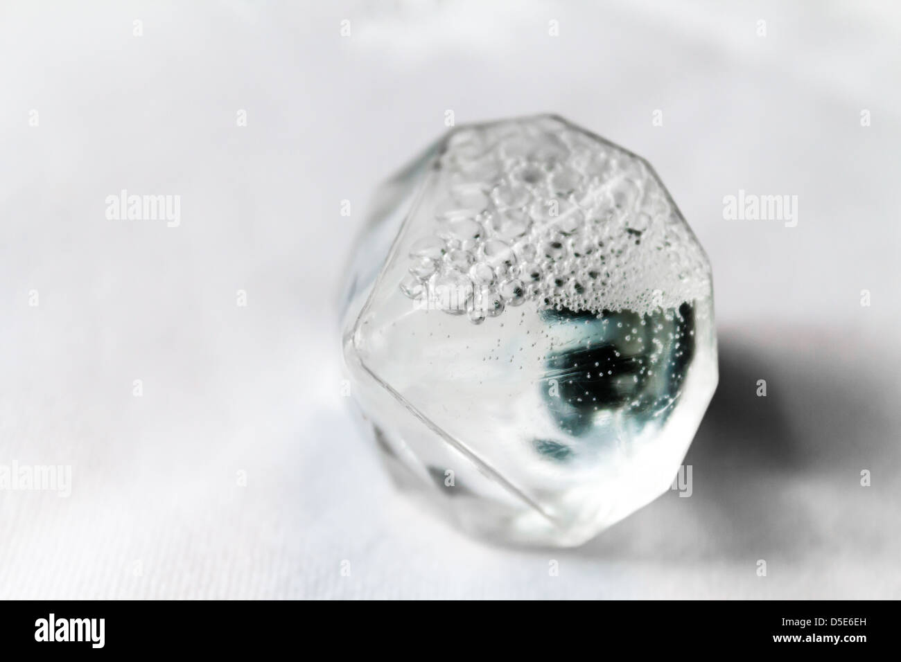 Bubble blowing liquid in a diamond shaped bottle. Often used at weddings for favours or at parties for adults with - Stock Image