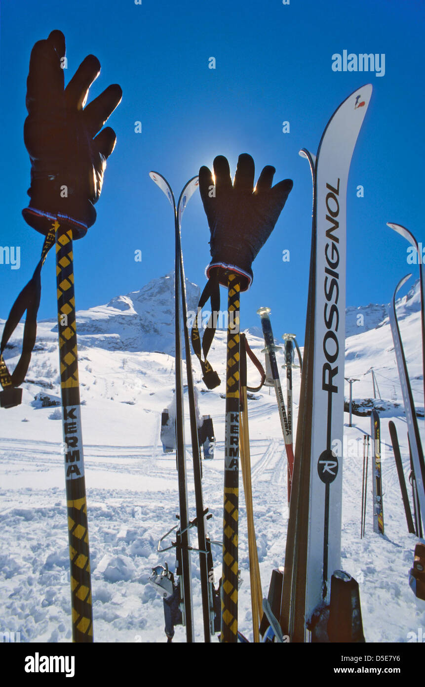 Skis outside a restaurant at a ski slope in Switzerland Stock Photo