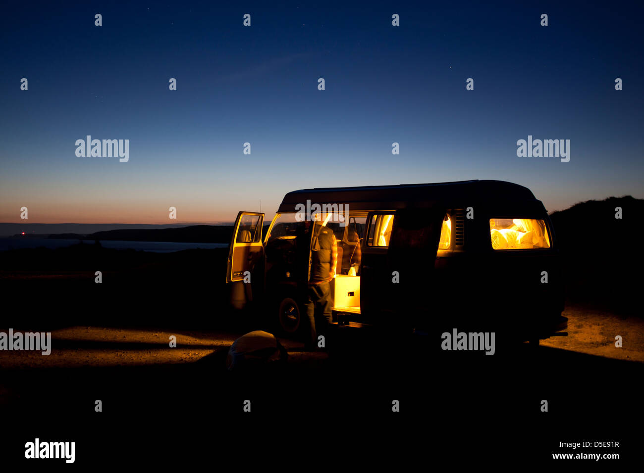 Old VW camper van in Wales at sunset. Stock Photo