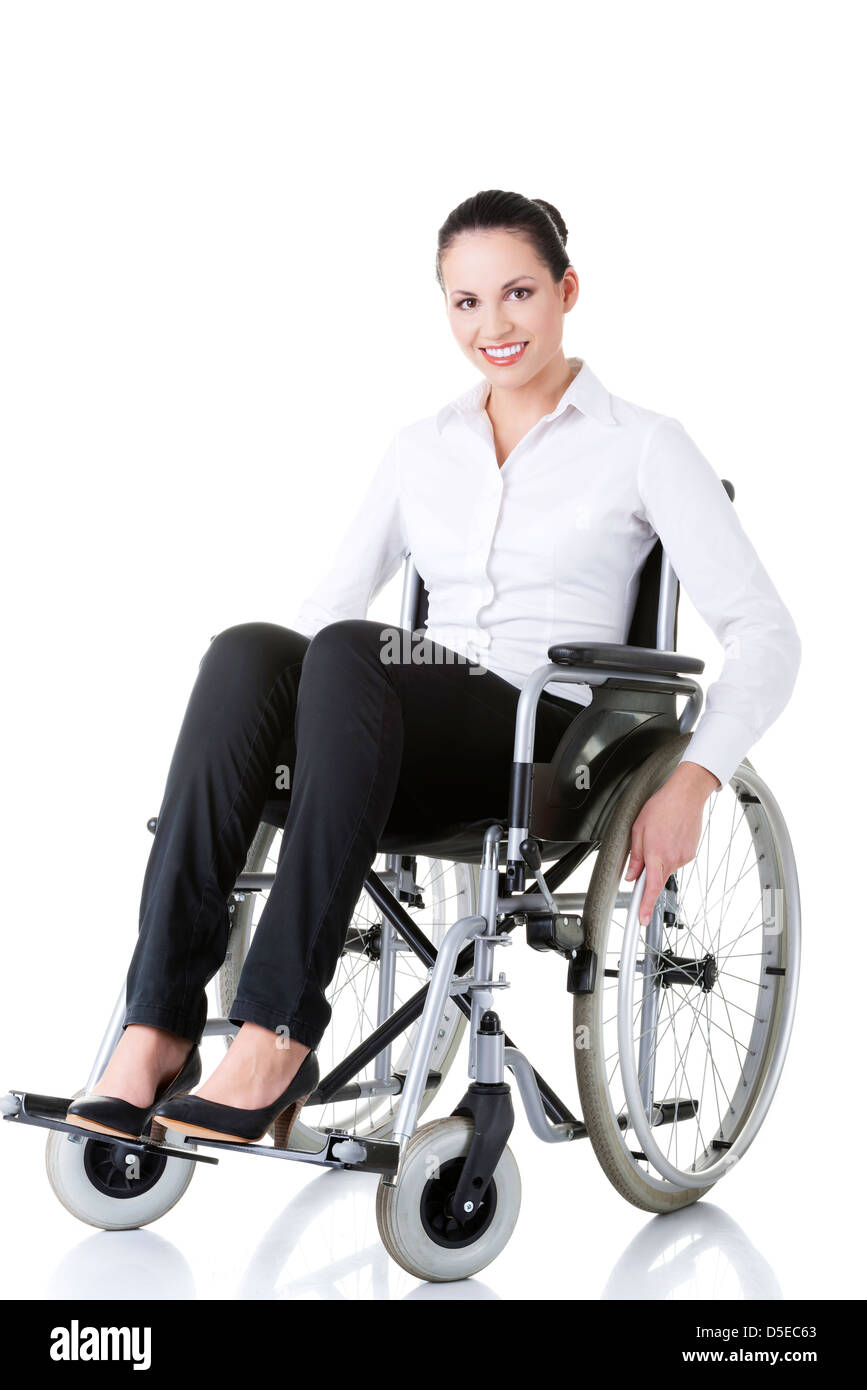 Attractive smiling disabled businesswoman sitting in a wheel chair ...