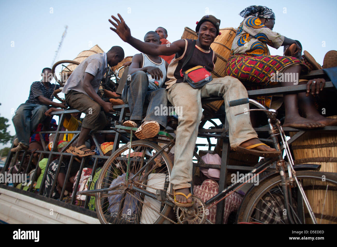 A bus loaded with people prepares to leave Nandom, in northern Ghana, for the journey south. - Stock Image