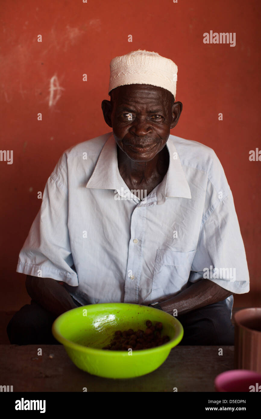 A man in a restaurant in Nandom, northern Ghana. - Stock Image