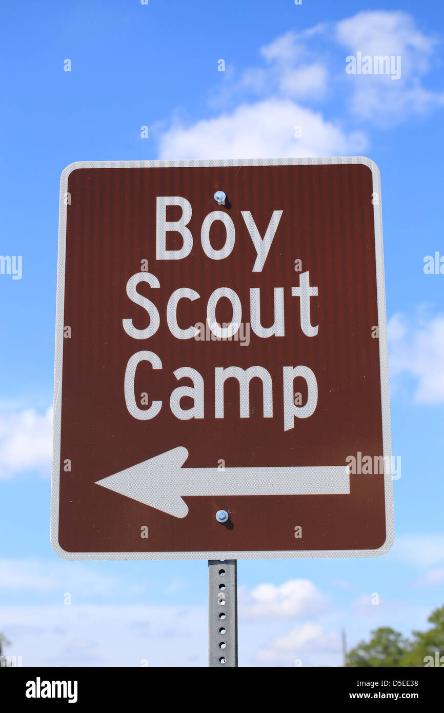 a road sign that says boy scout camp with an arrow to the left - Stock Image