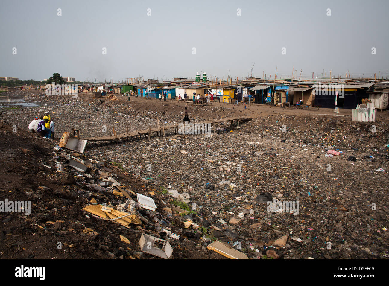 A heavily polluted river in the Agbogbloshie suburb of Accra, Ghana. - Stock Image