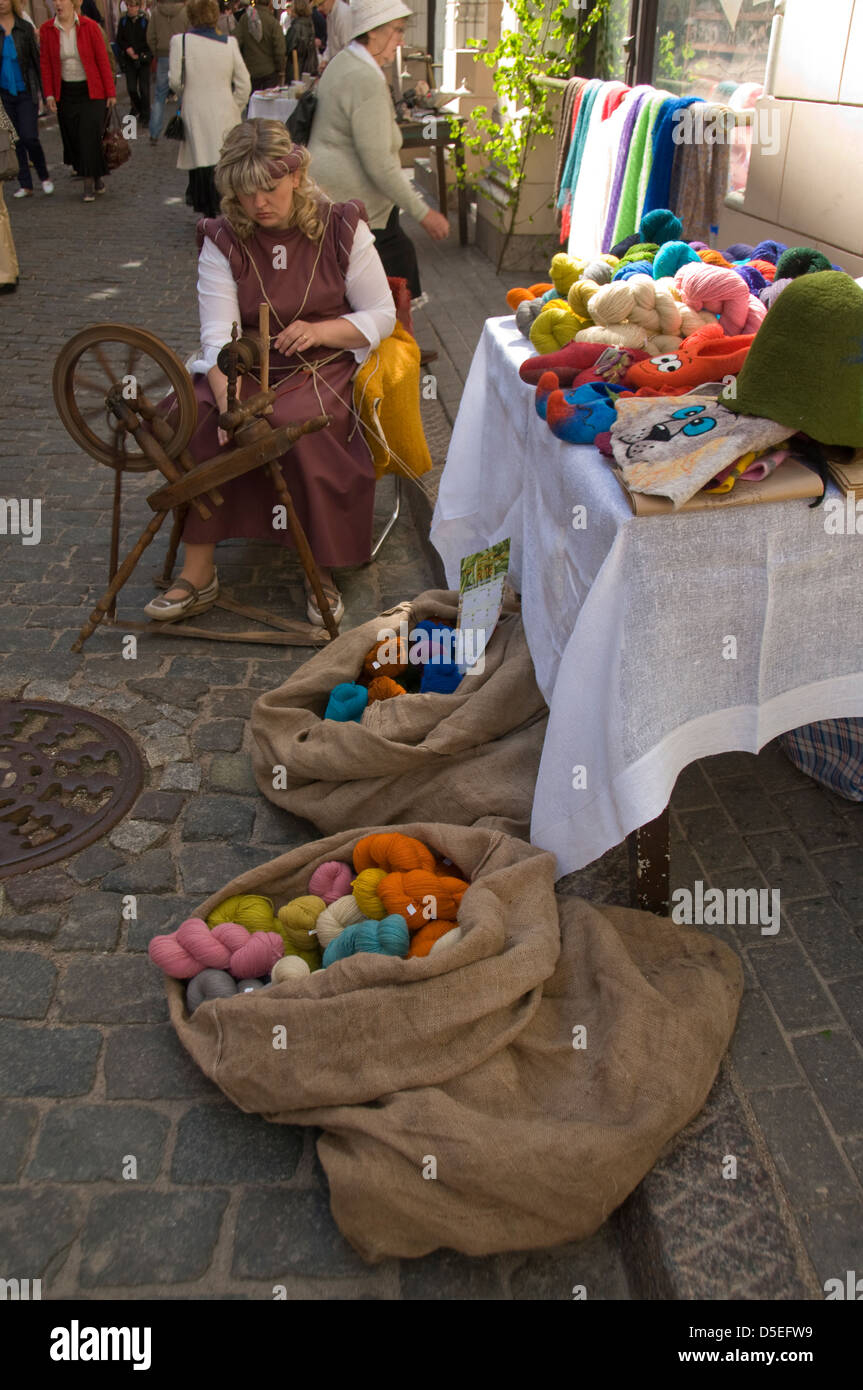 A wool spinner taking part in the old Latvian culture show in Amatu iela,Riga old town,Riga,Latvia,Baltic States - Stock Image