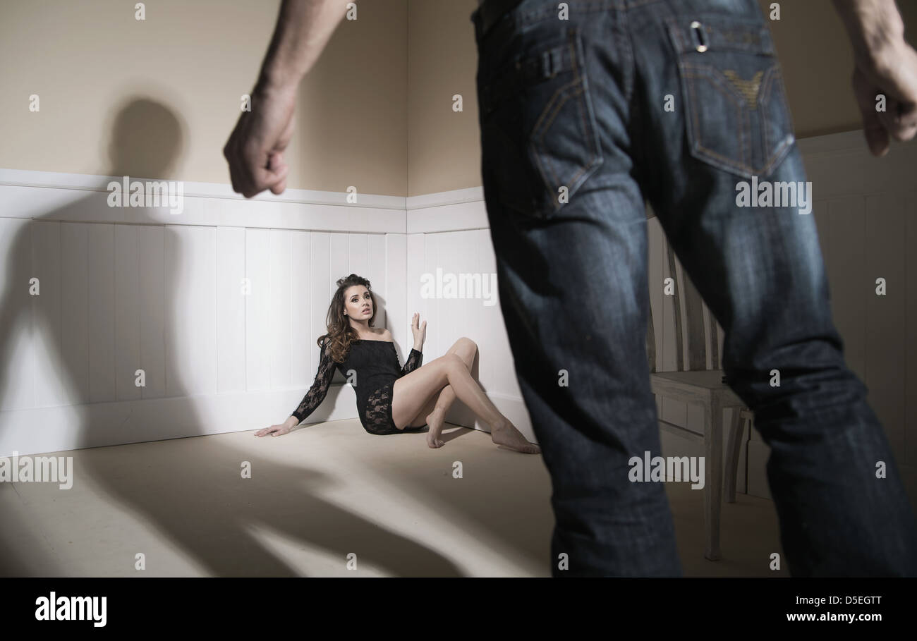 Scene of man and his wife expressing domestic violence - Stock Image