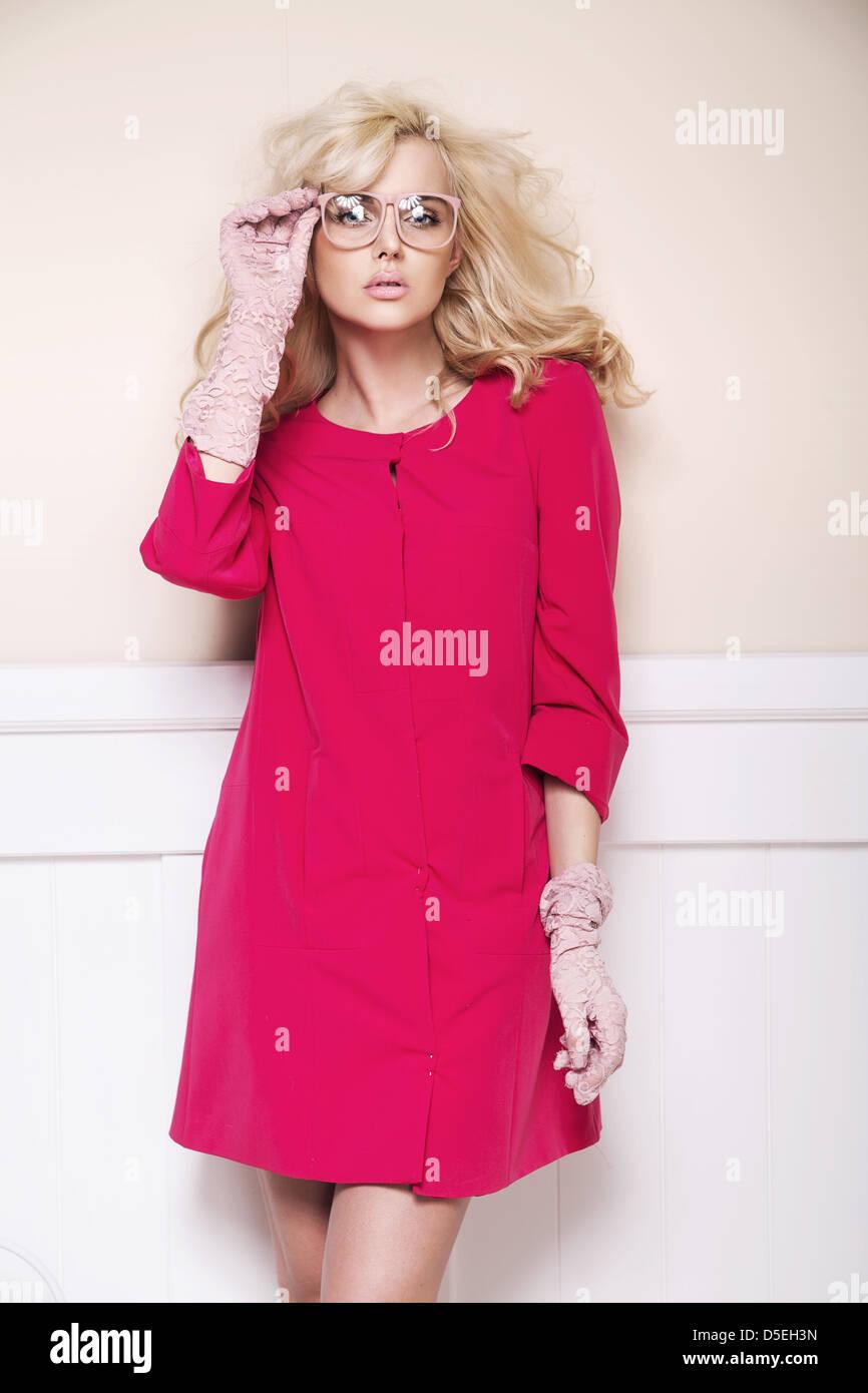 Amazing blonde lady presenting summer fashion - Stock Image