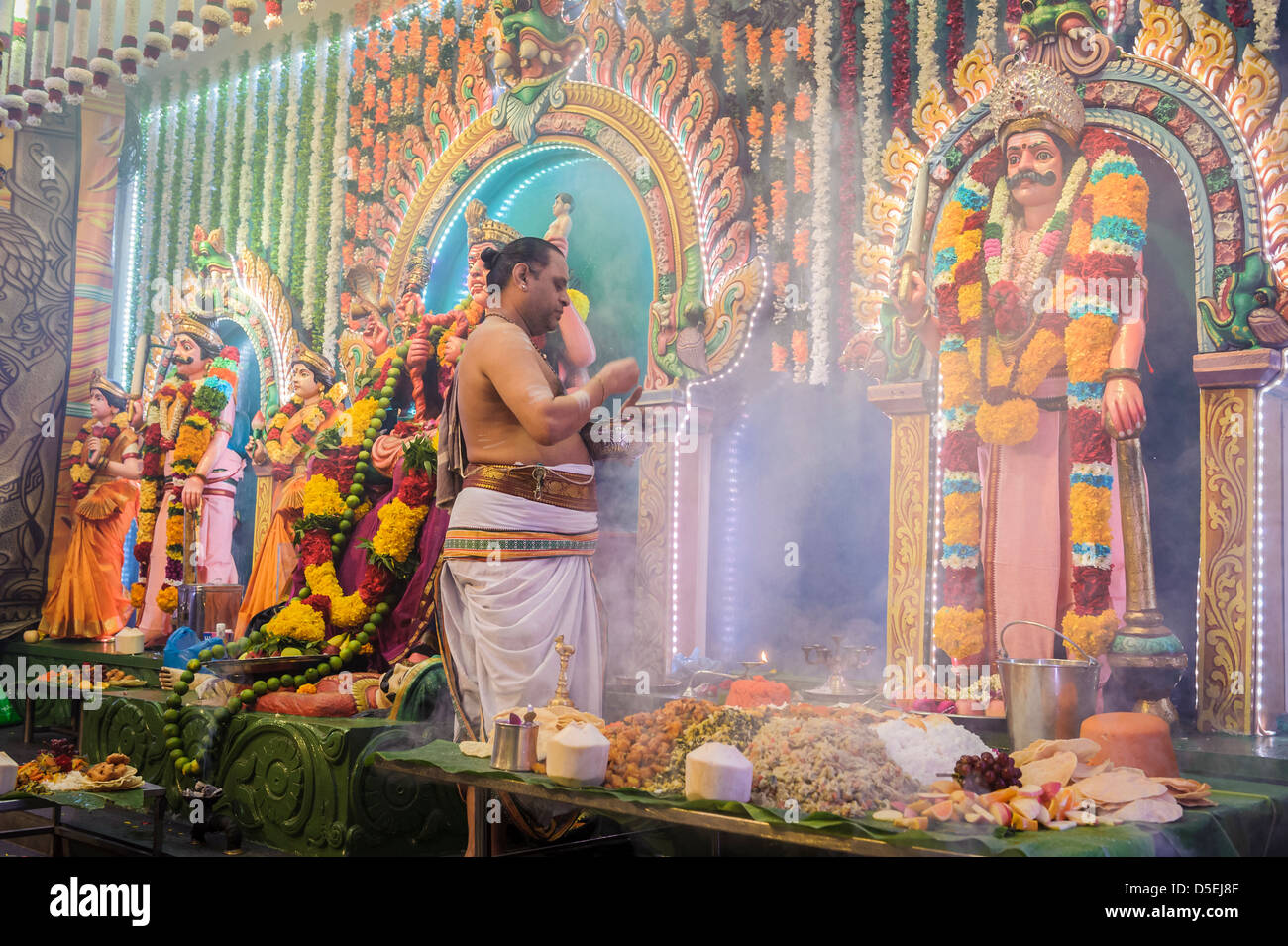 Priest performing a hinduist ceremony, Singapore, Asia. - Stock Image