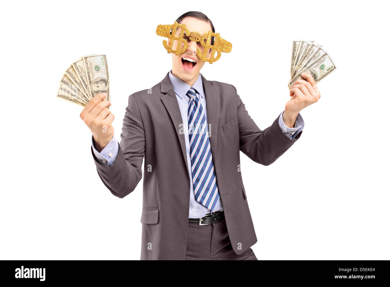 6a328cf352d6 A happy man wearing dollar sign glasses and holding US dollars isolated on  white background -