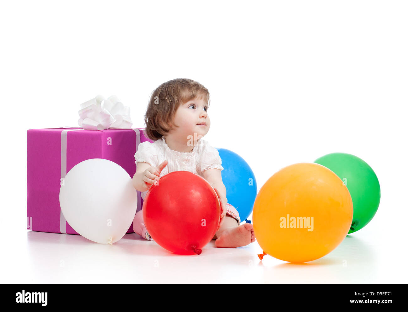 girl with colorful balloons and gift. Isolated on white. - Stock Image