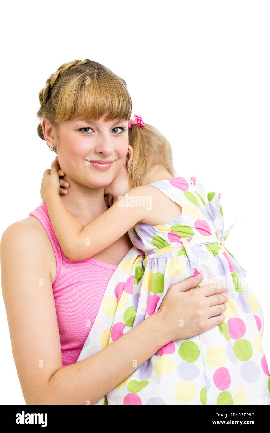 Mother embracing her daughter child isolated - Stock Image