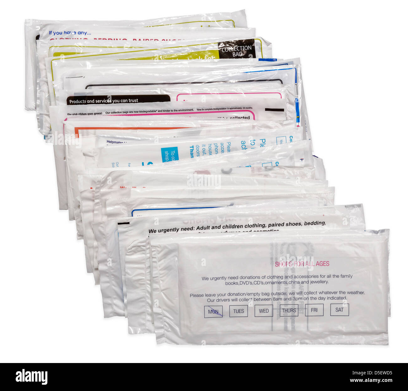 Stack of doorstep plastic charity bags - Stock Image