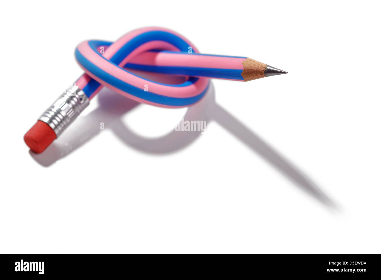 Pencil tied in a knot - Stock Image
