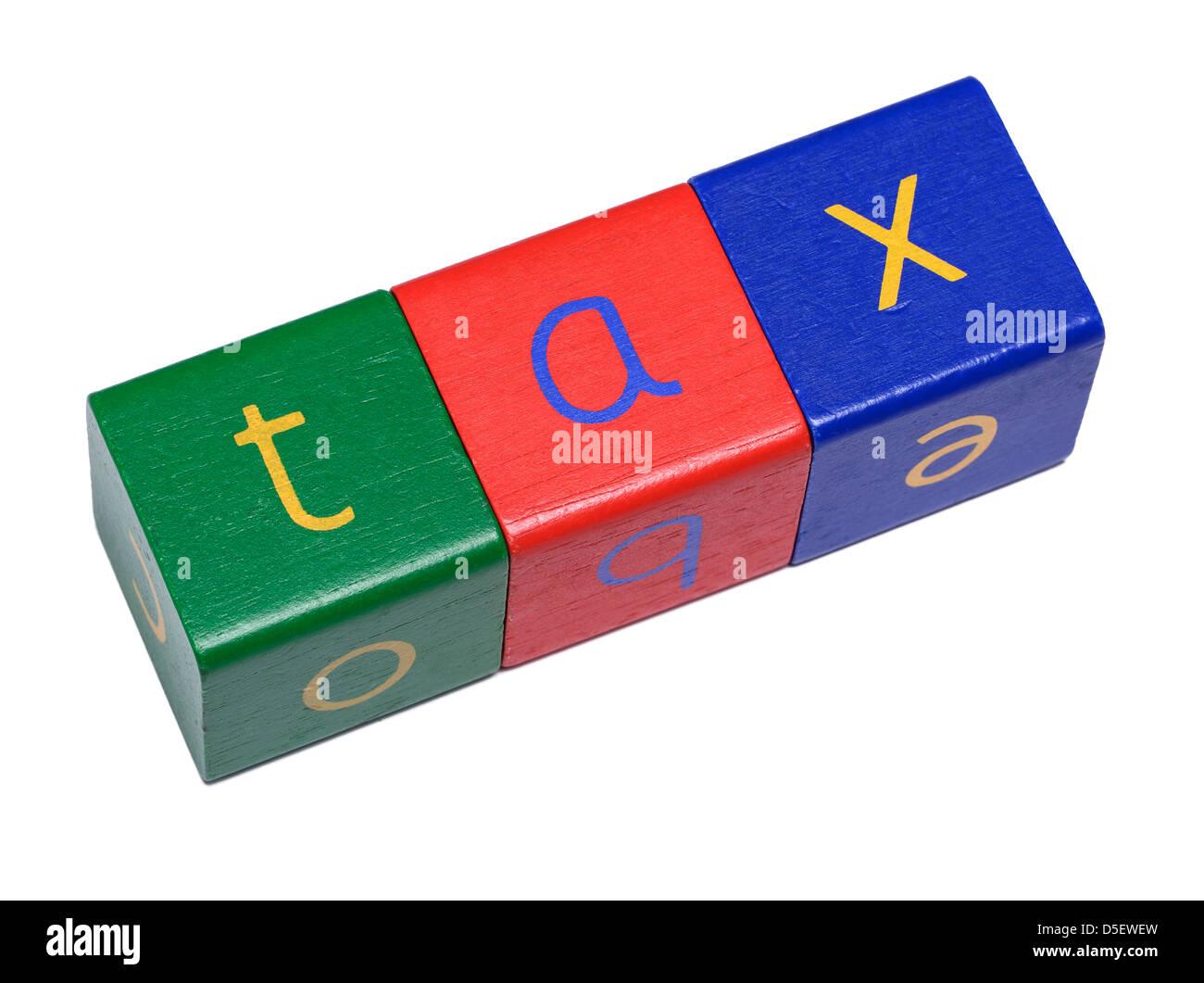 Wooden blocks spelling TAX - Stock Image