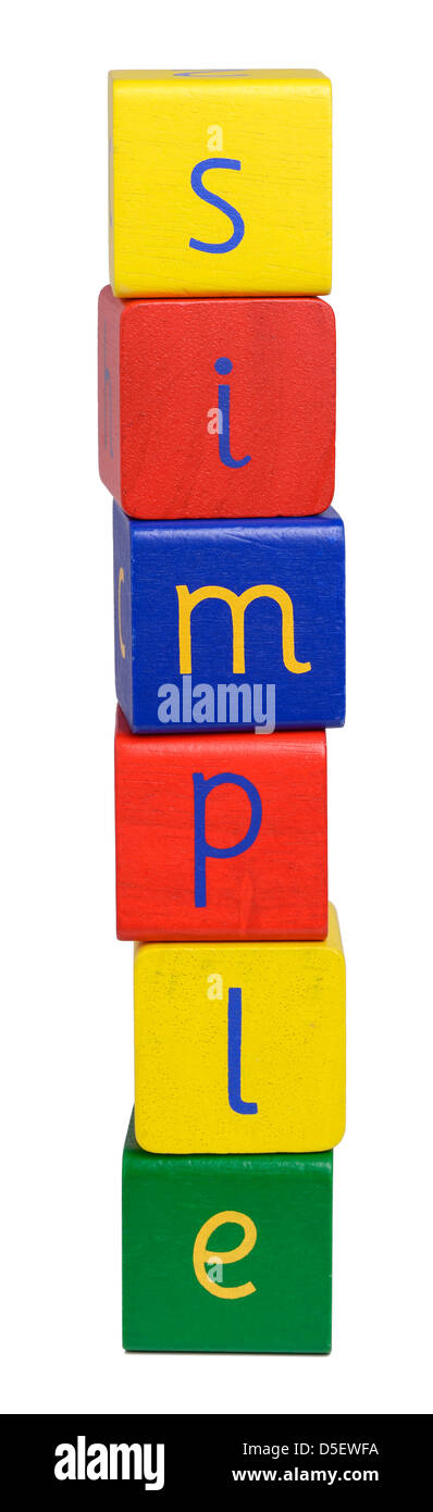 Wooden blocks spelling SIMPLE - Stock Image