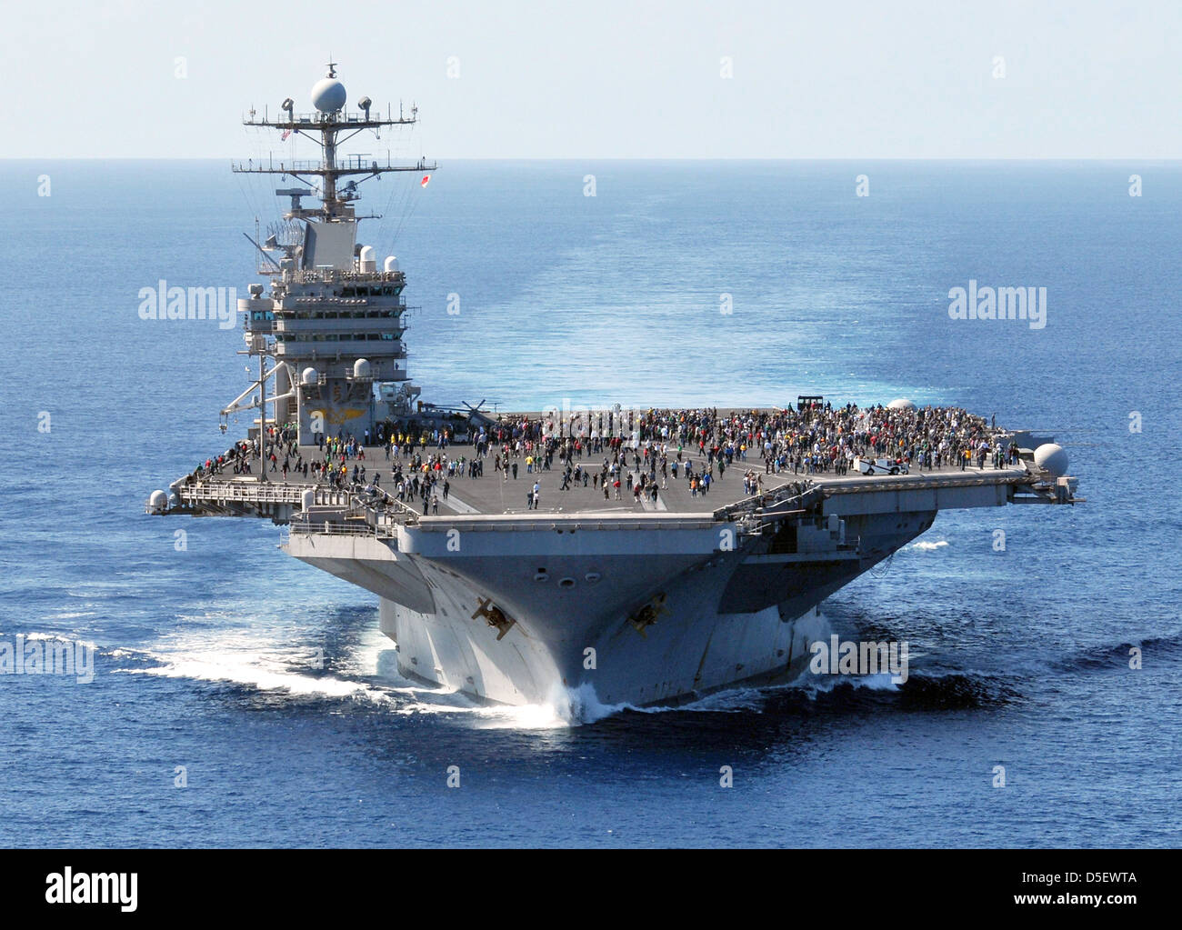 US Navy Nimitz-class nuclear aircraft carrier USS Abraham Lincoln returns to home port August 6, 2012 Norfolk, VA. - Stock Image