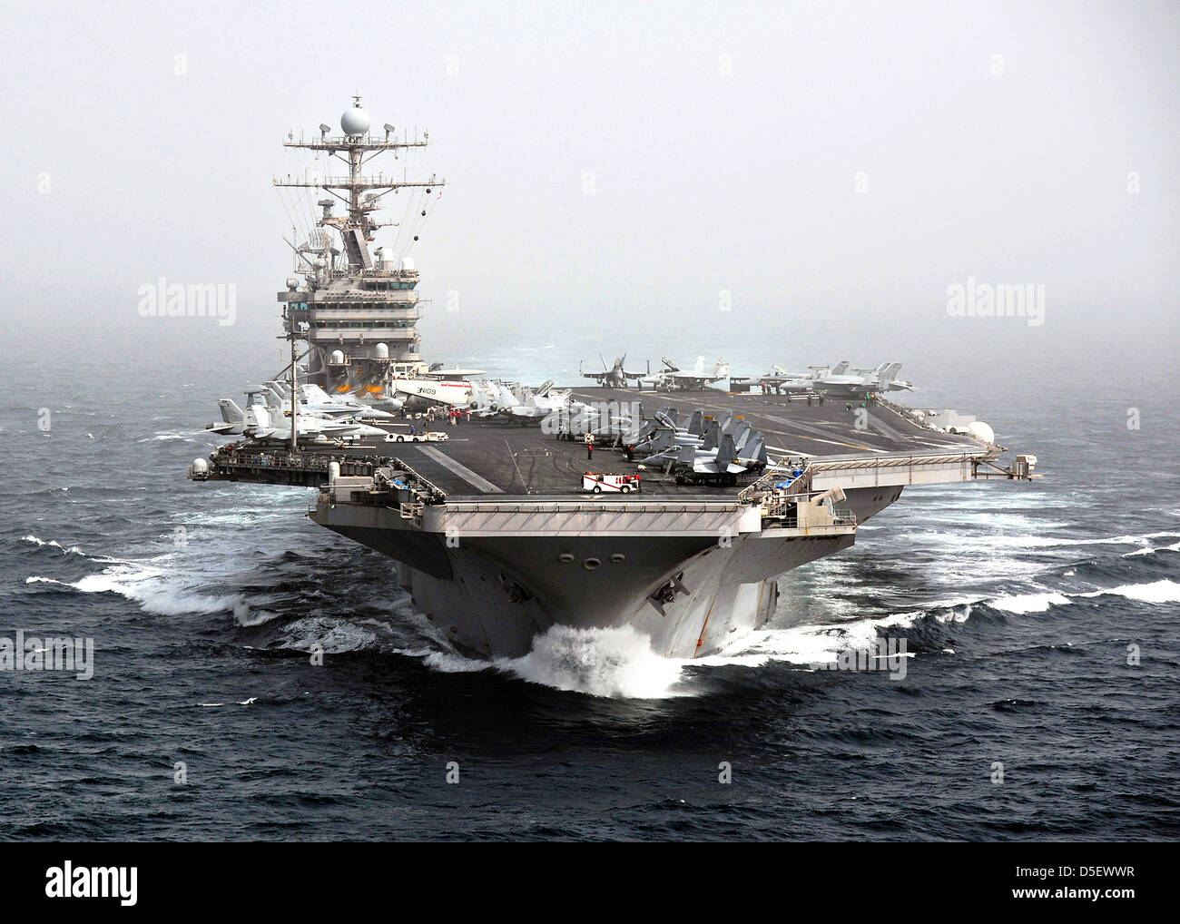 US Navy Nimitz-class nuclear aircraft carrier USS Abraham Lincoln operating as part of the 5th Fleet December 5, - Stock Image