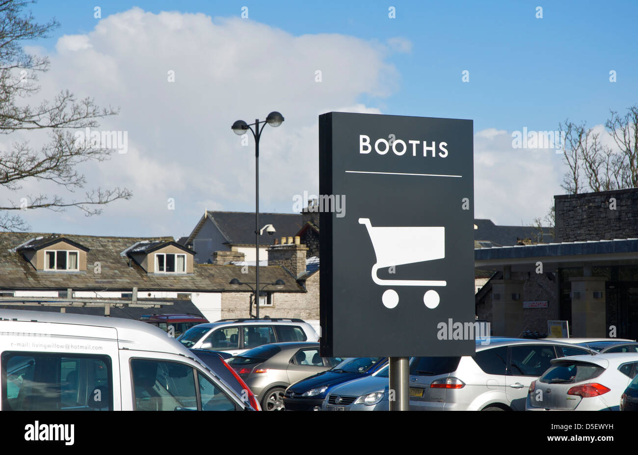 Sign for trolley park in car-park of Booths supermarket, Kendal, Cumbria, England UK - Stock Image