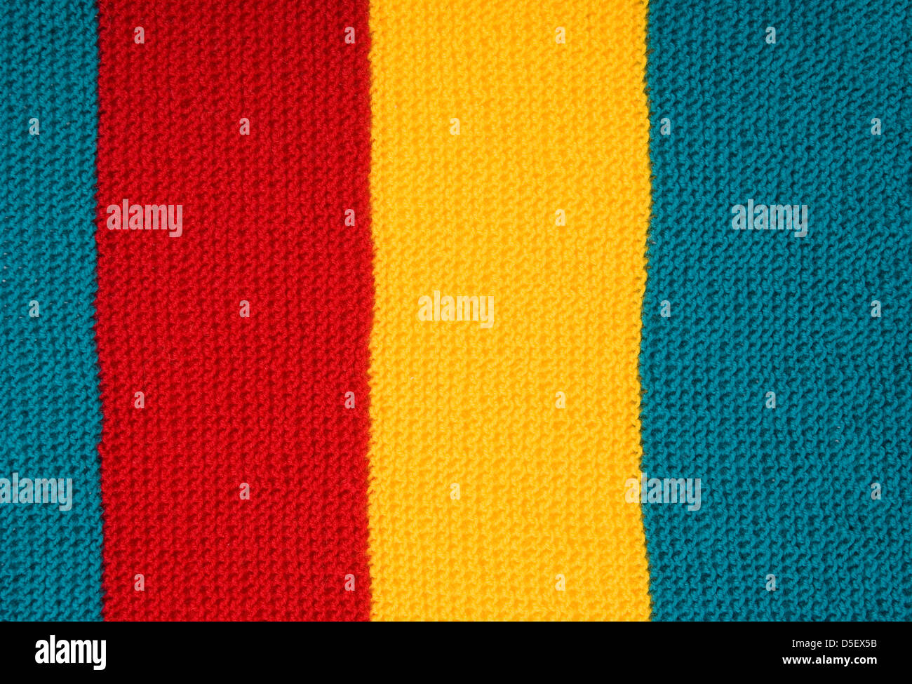 woolen needlework with three colours as background - Stock Image