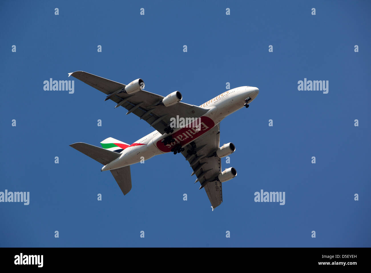 England, Berkshire, Windsor, Emirates Airbus A380 flying low on final approach to Heathrow - Stock Image