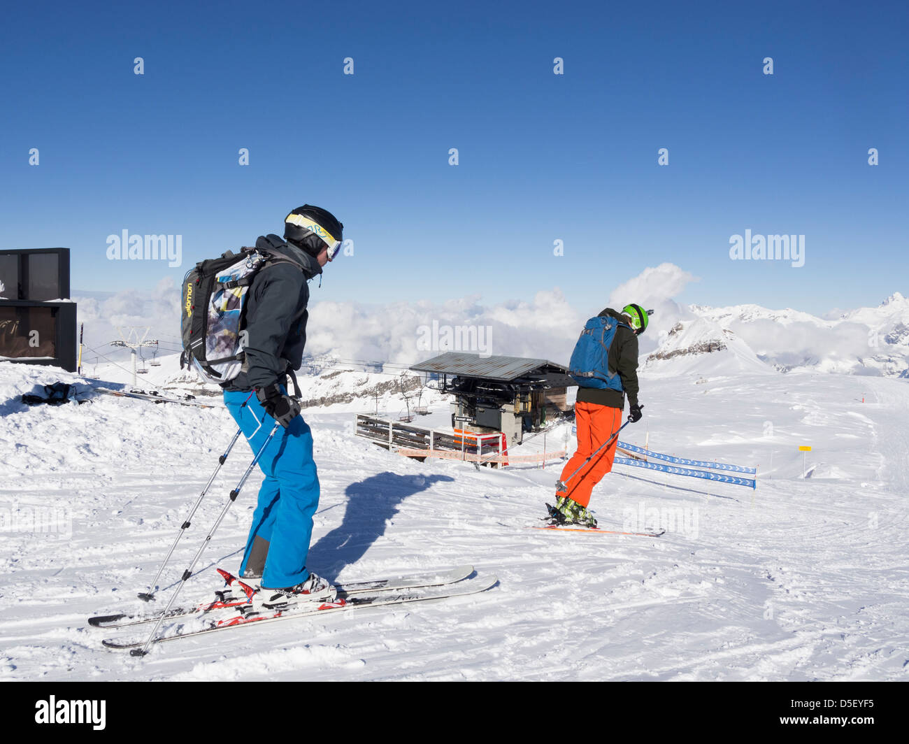 Two men skiers skiing on Les Grandes Platieres in Le Grand Massif ski area of French Alps. Flaine 1600 - 2500 Rhone - Stock Image