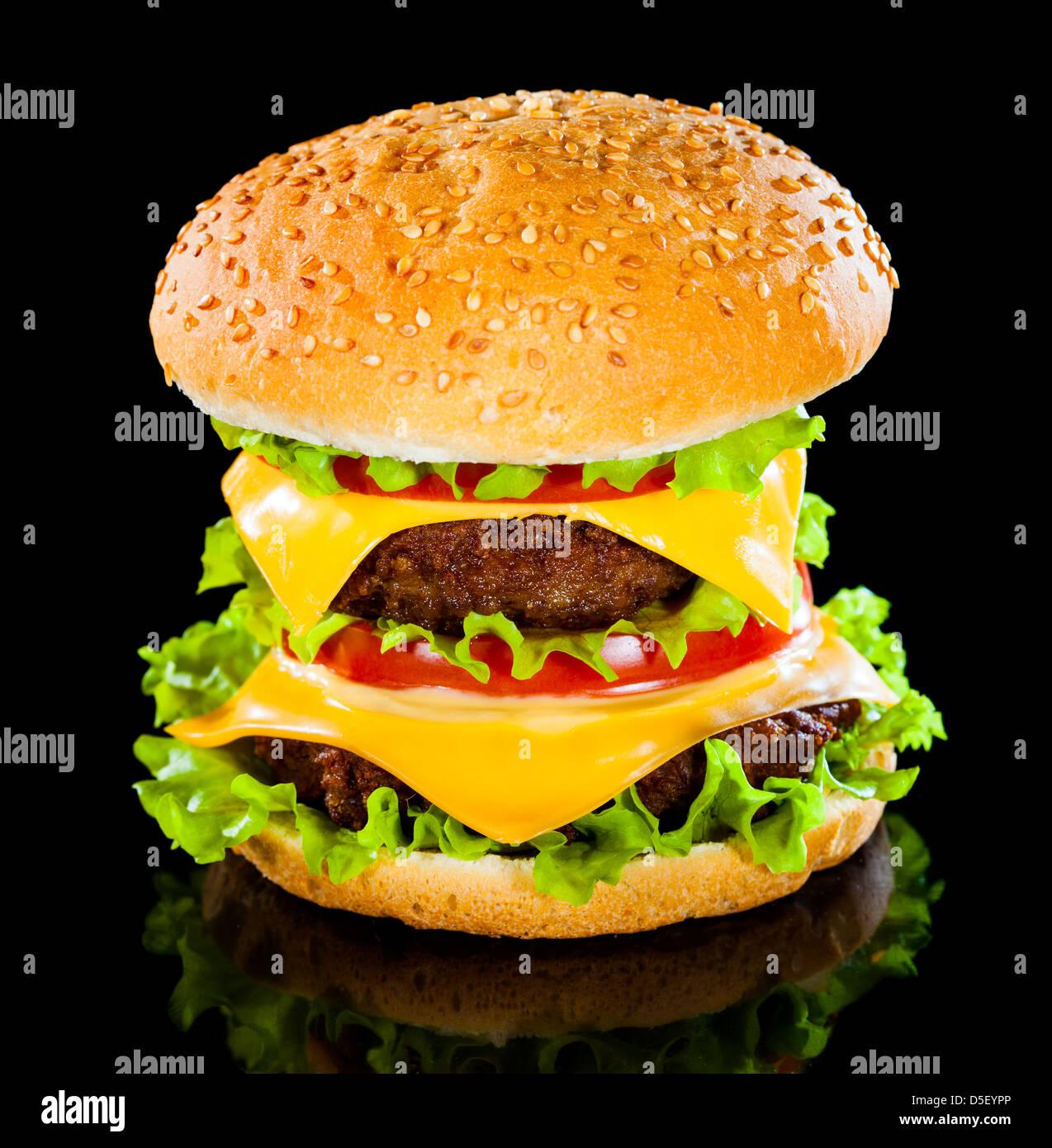 Tasty and appetizing hamburger on a darkly background - Stock Image