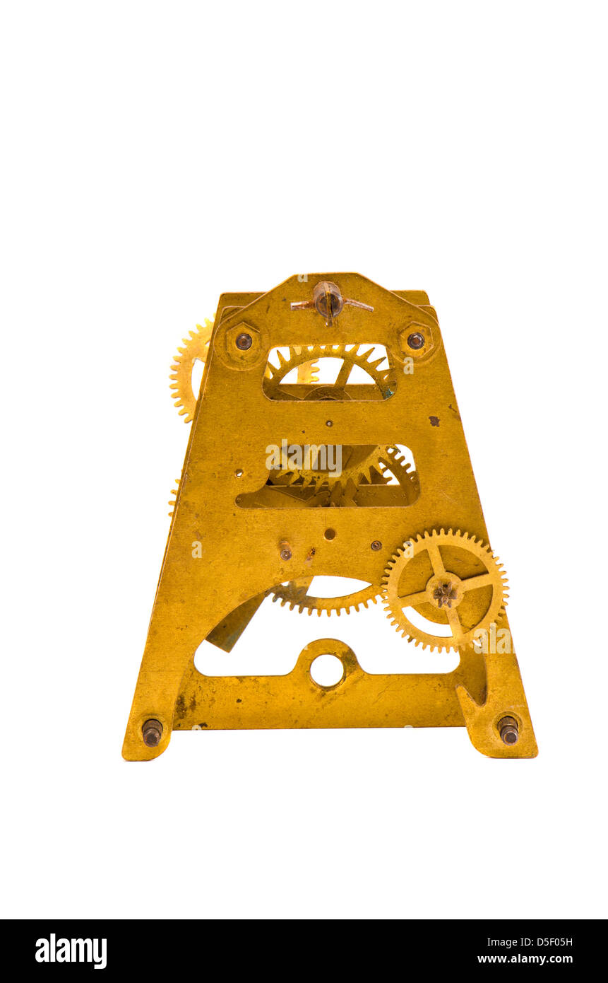 old clock brass part with gearwheel isolated on white background - Stock Image