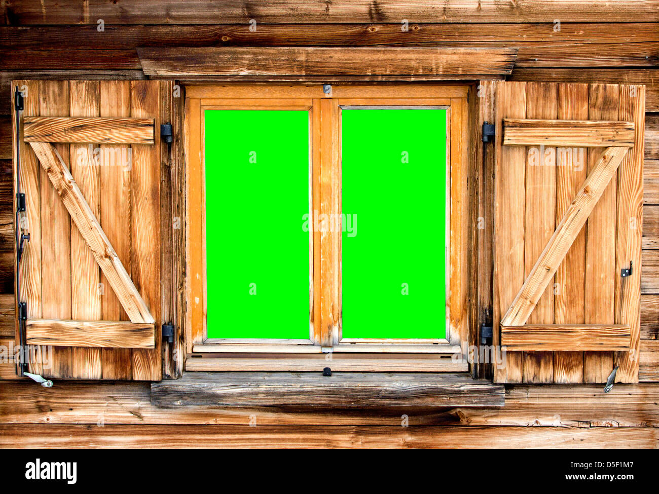 Weathered facade of a mountain hut with green screen