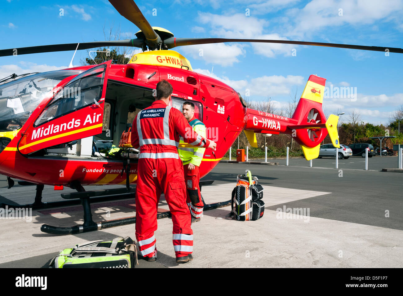 Midlands Air Ambulance landed in the car park at Hereford Hospital. Air ambulance paramedic stowing the stretcher - Stock Image