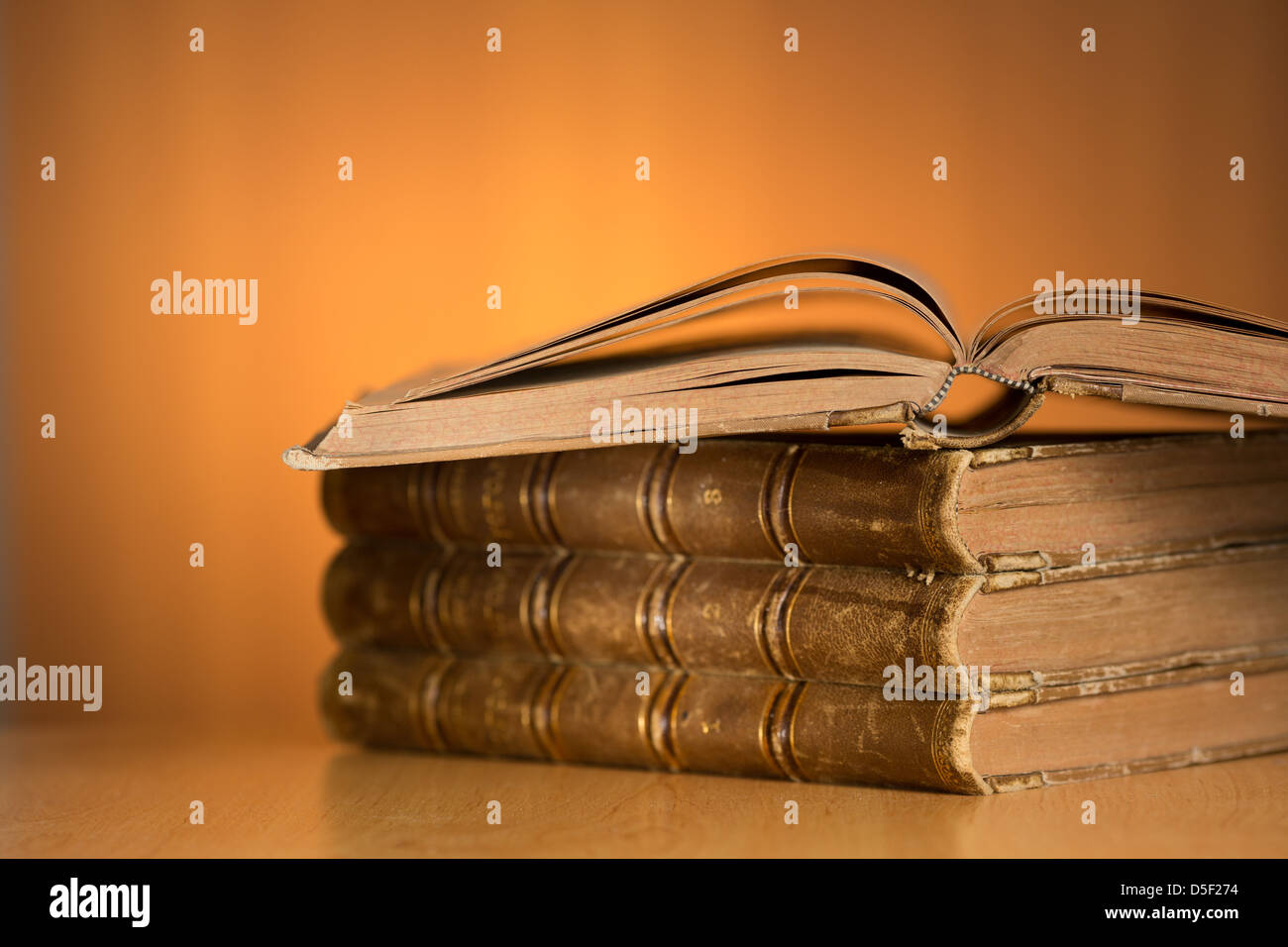 old grunge books on wooden table with free space for your text - Stock Image