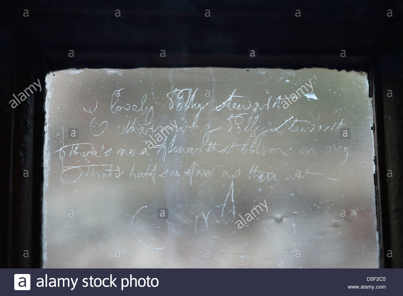 A poem scratched on a window pane by Robert Burns, in an upstairs room of the Globe Inn, Dumfries, Dumfries & - Stock Image