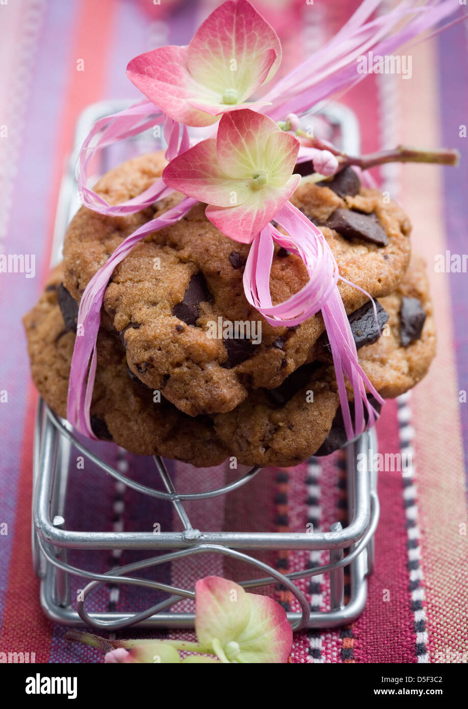 Pile of delicious chocolate chip cookies on table - Stock Image