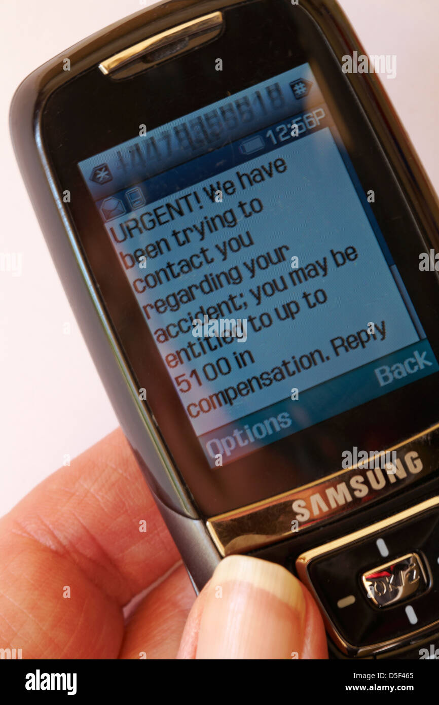urgent text message received on mobile phone about compensation for accident - Stock Image