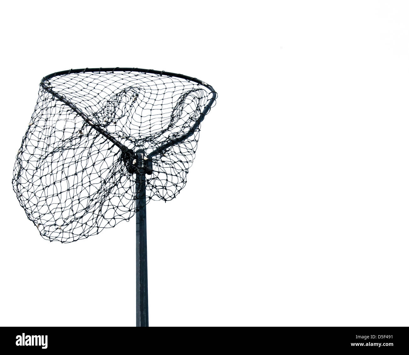 An empty fishing net against the white sky. - Stock Image