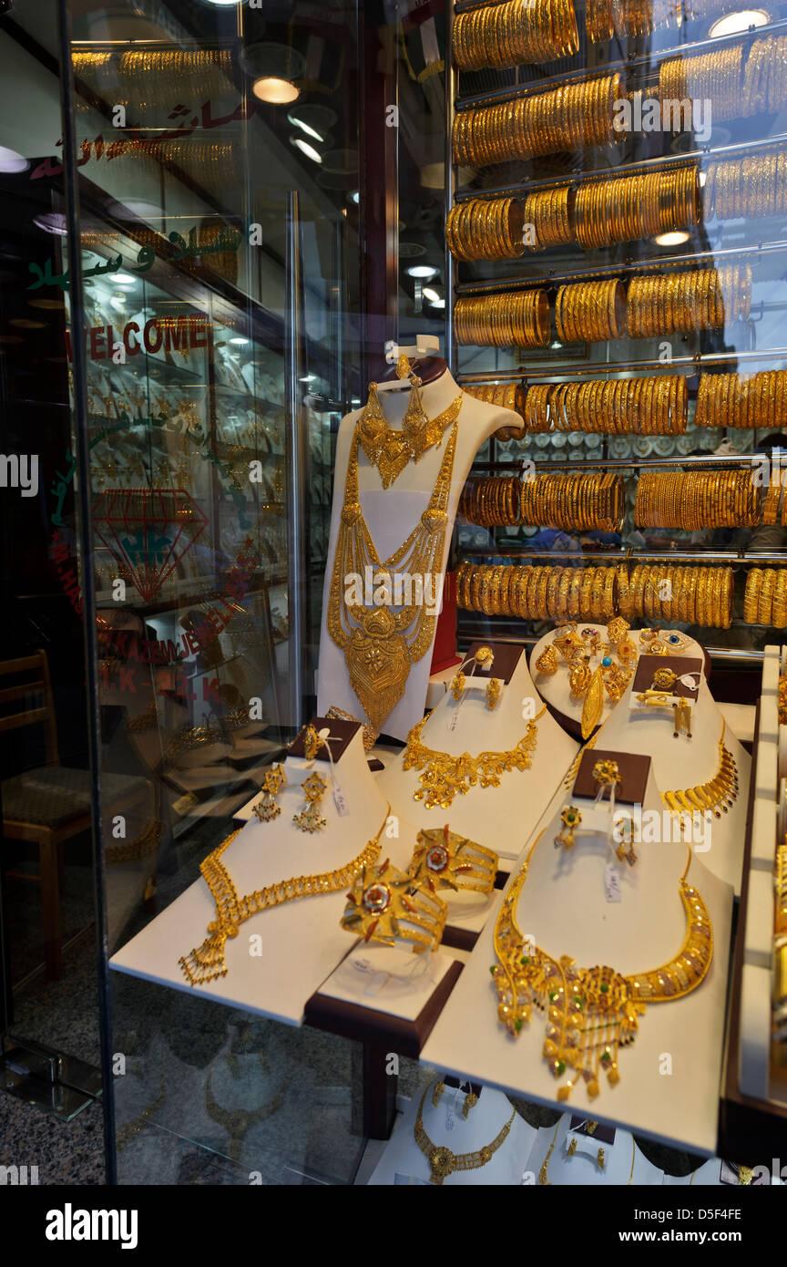 Gold jewellery - rings, necklaces, bracelets for sale, Dubai Gold Souk, United Arab Emirates. - Stock Image