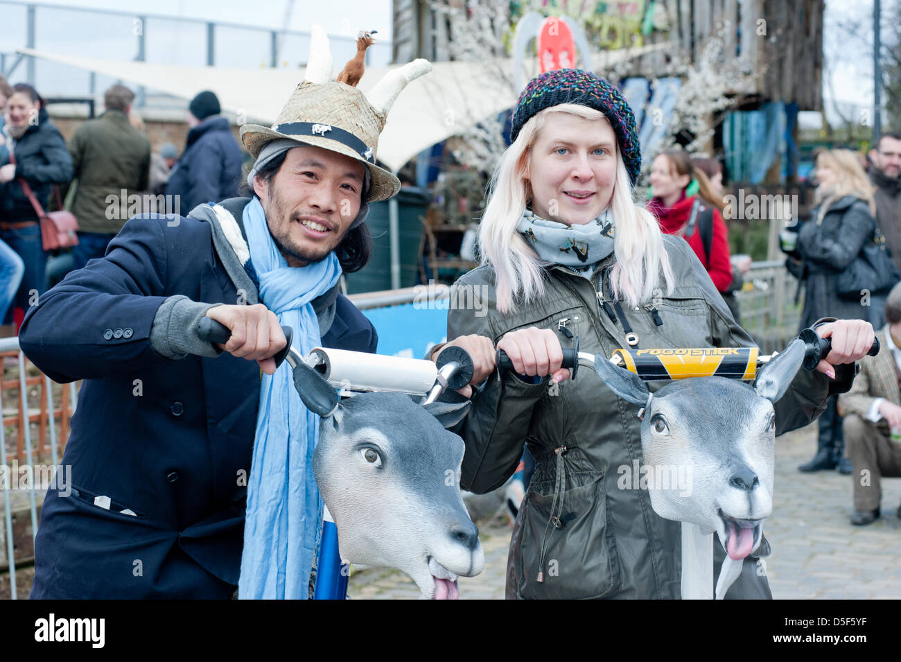 London, UK - 31 March 2013: people visit the 5th Annual Oxford and Cambridge Goat Race that takes place at Spitalfields - Stock Image