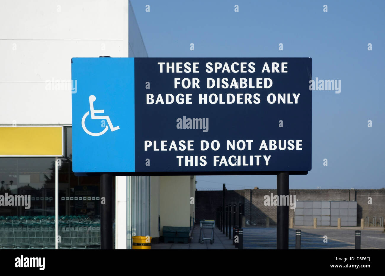 A sign for disabled parking in a supermarket car park, uk - Stock Image