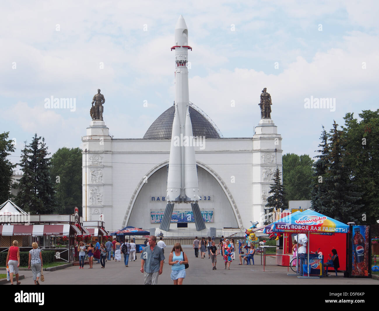 The Aerospace (Mechanization) Pavilion and Vostok Rocket at the All-Russia Exhibition Center in Moscow, Russia - Stock Image