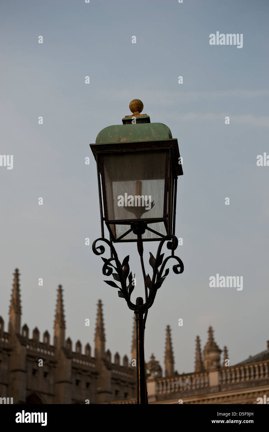 A traditional iron lamp stands outside Kings College, Cambridge. - Stock Image