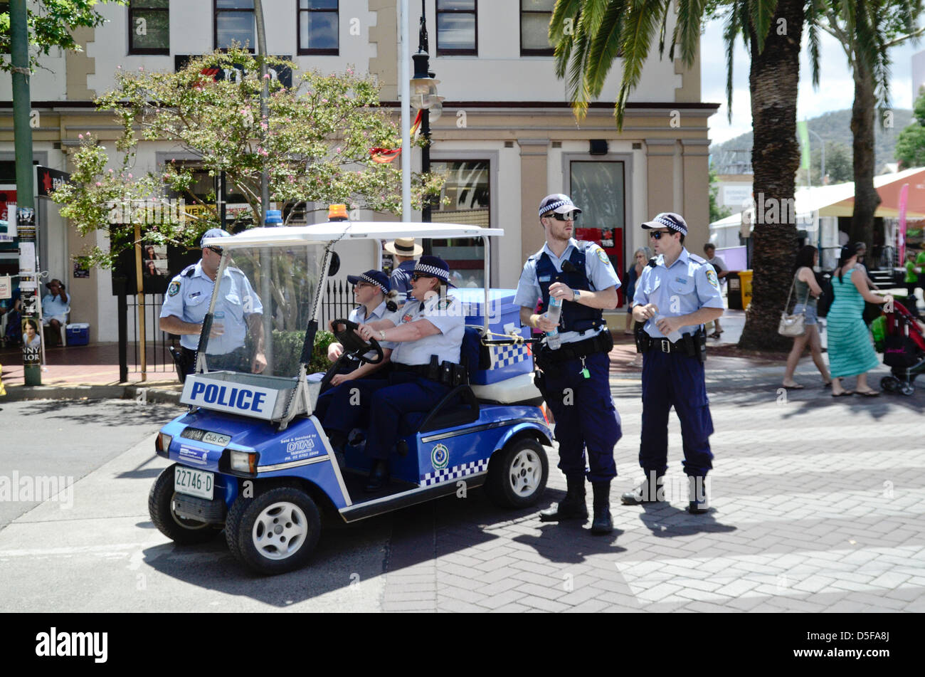 Australian police on street patrol using a golf buggy during Tamworth Music Festival 2013 - Stock Image