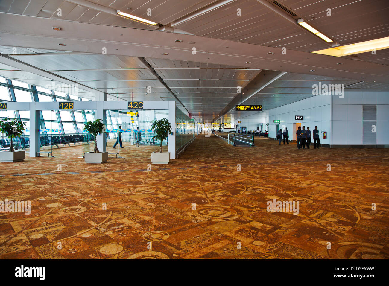 People at an airport terminal, Shimla Airport, Shimla, Himachal Pradesh, India - Stock Image