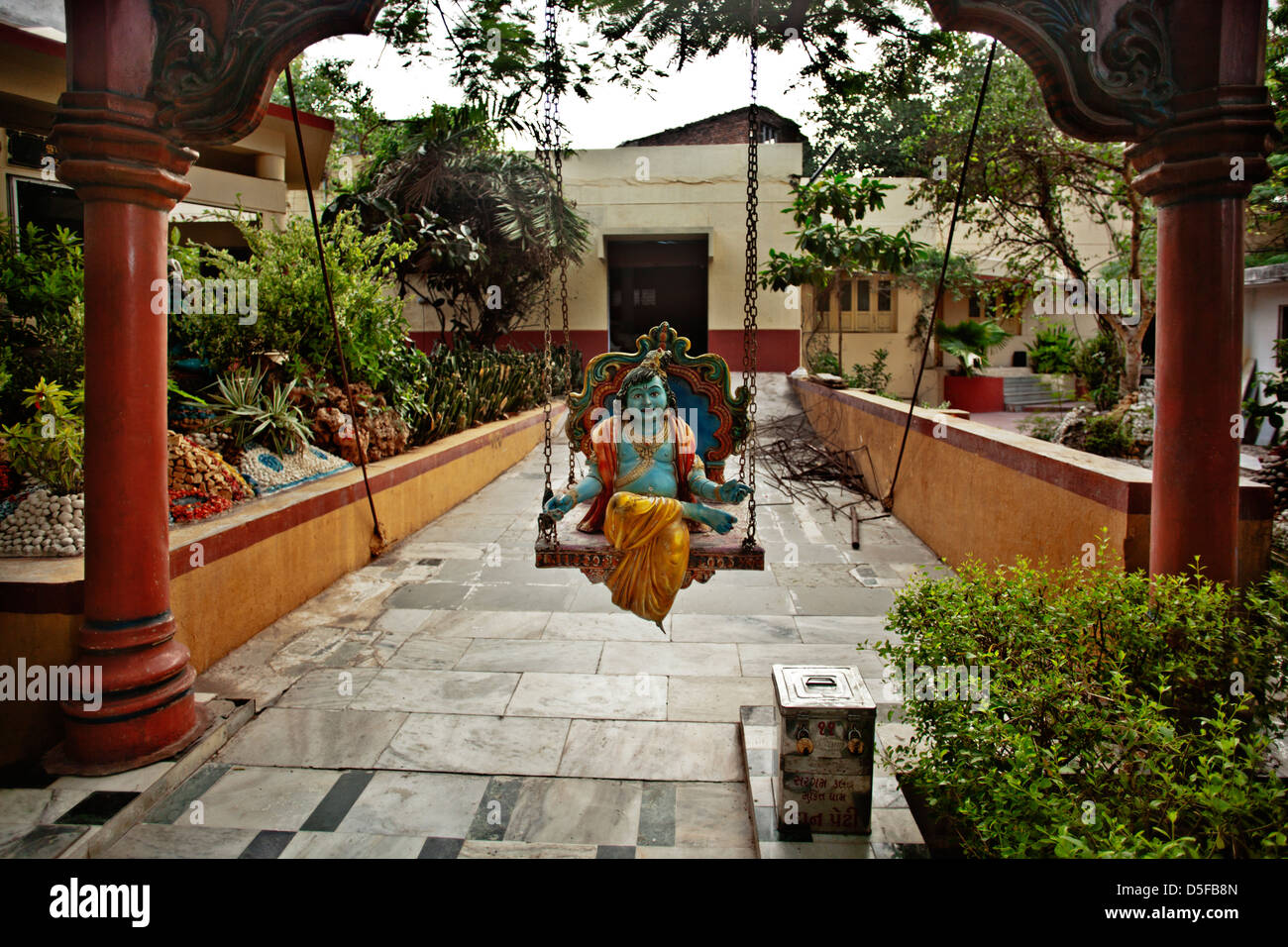 Lord Krishna On Jhula In A Garden Rajkot Gujarat India Stock