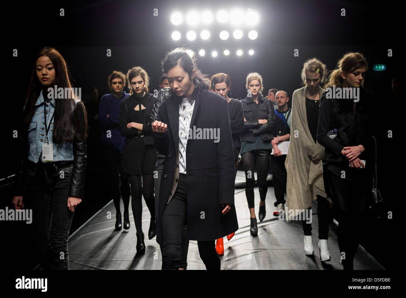Models prepare ahead of the Zoe Jordan collection during London Fashion Week. - Stock Image