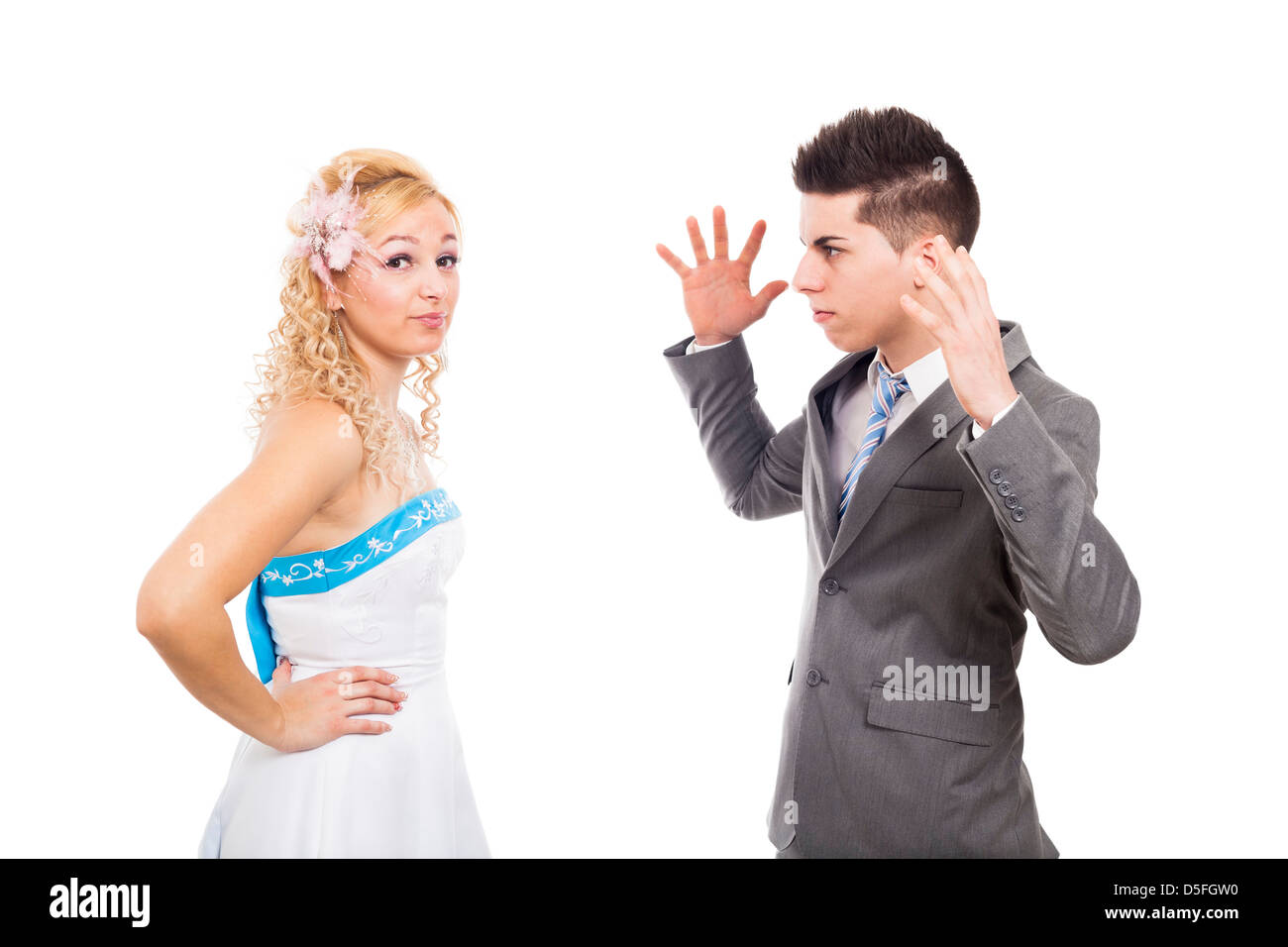 Unhappy bride and angry groom arguing, isolated on white background - Stock Image